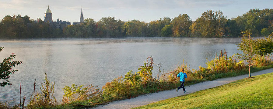 Jogger near the lake at the University of Notre Dame